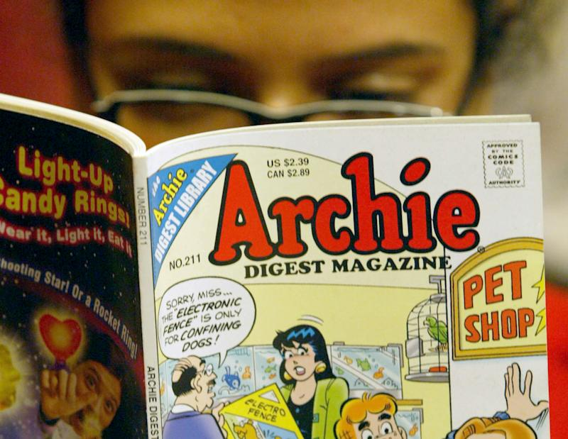 FILE- In this  Monday, May 7, 2007, file photo, a girl  reads an Archie comic at Oxford Book Shop in Calcutta, India. The two CEOs of the company that publishes Archie comics on Wednesday, June 6, 2012, ended their court feud over control of the comics kingdom, but now some relatives are accusing both sides of funny business. (AP Photo/Bikas Das, File)