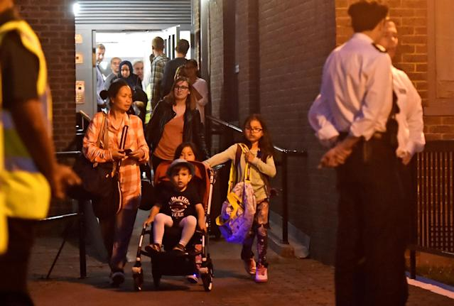 <p>Residents are evacuated from the Taplow Tower residential block as a precautionary measure following concerns over the type of cladding used on the outside of the building on the Chalcots Estate in north London, Britain, June 23, 2017. (Photo: Hannah McKay/Reuters) </p>