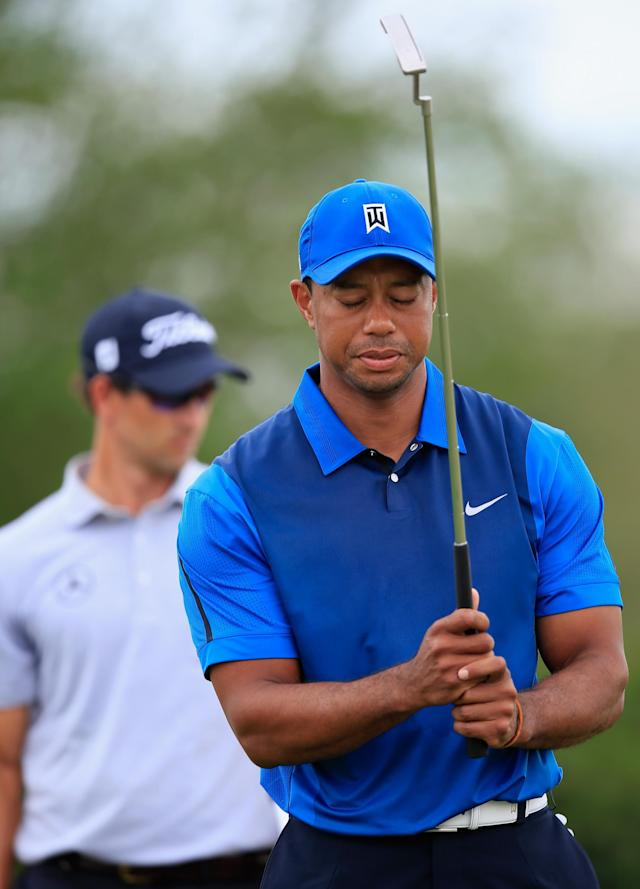 DORAL, FL - MARCH 06: Tiger Woods reacts to a missed putt on the second green during the first round of the World Golf Championships-Cadillac Championship at Trump National Doral on March 6, 2014 in Doral, Florida. (Photo by Jamie Squire/Getty Images)