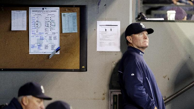 Seattle Mariners manager Eric Wedge looks out from the dugout during a baseball game against the Oakland Athletics Sunday, Sept. 29, 2013, in Seattle. Wedge announced days earlier that he would not be returning for the next season. (AP Photo/Elaine Thompson)