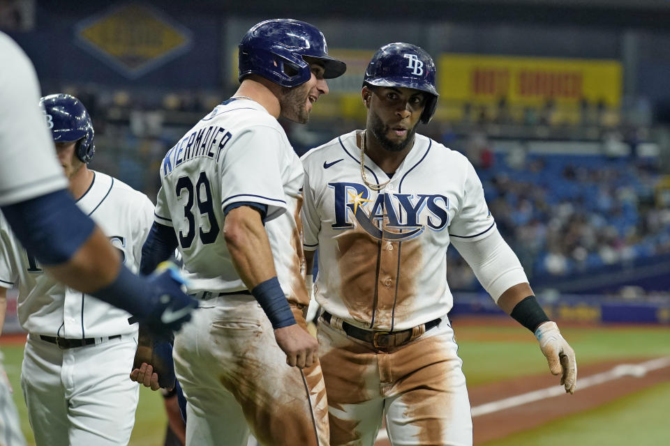 Tampa Bay Rays' Yandy Diaz celebrates his three-run home run off Toronto Blue Jays starting pitcher Robbie Ray with Kevin Kiermaier (39) during the fifth inning of a baseball game Monday, Sept. 20, 2021, in St. Petersburg, Fla. (AP Photo/Chris O'Meara)