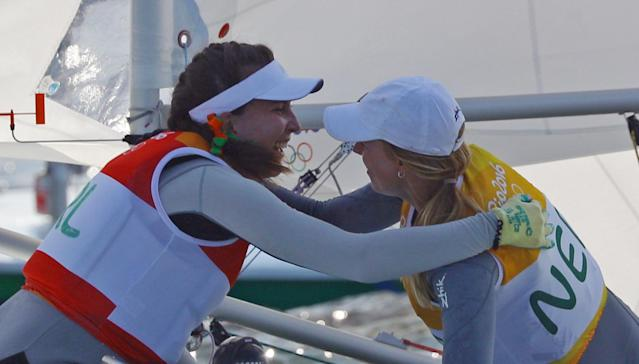 2016 Rio Olympics - Sailing - Final - Women's One Person Dinghy - Laser Radial - Medal Race - Marina de Gloria - Rio de Janeiro, Brazil - 16/08/2016. Marit Bouwmeester (NED) of Netherlands is congratulated by silver medalist Annalise Murphy (IRL) of Ireland. REUTERS/Brian Snyder FOR EDITORIAL USE ONLY. NOT FOR SALE FOR MARKETING OR ADVERTISING CAMPAIGNS.