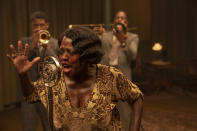 "This image released by Netflix shows Chadwick Boseman, from left, Viola Davis and Colman Domingo in ""Ma Rainey's Black Bottom."" (David Lee/Netflix via AP)"