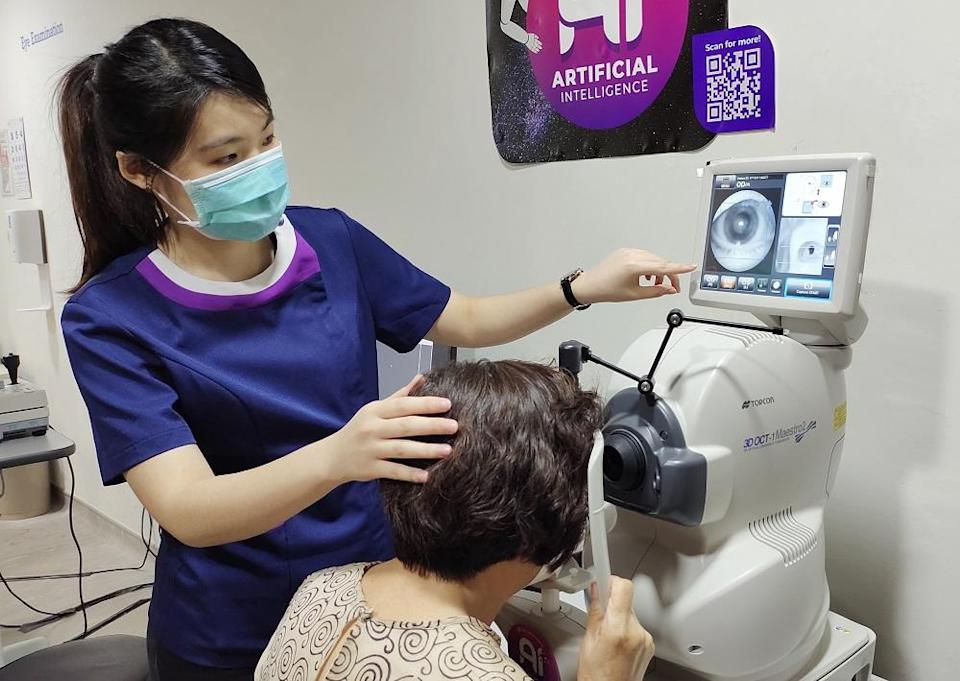 An optometrist checks a patient's retina and optic nerve using the OCT machine. ― Picture courtesy of VISTA Eye Specialist