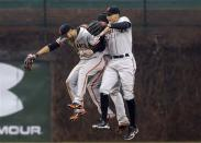From left, San Francisco Giants' Gregor Blanco, Angel Pagan and Hunter Pence celebrate their 7-6 win over the Chicago Cubs in a baseball game in Chicago, Thursday, April 11, 2013. (AP Photo/Nam Y. Huh)