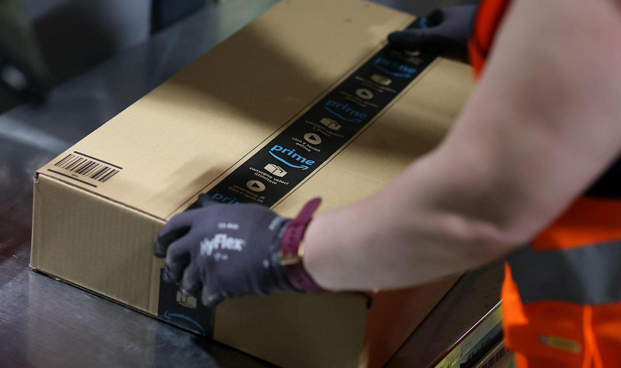 An employee prepares a package for shipment at the Amazon logistics centre in Suelzetal, eastern Germany, on Mai 12, 2021. - The US online sales giant opened the new warehouse in Saxony-Anhalt in August 2020. (Photo by Ronny Hartmann / AFP) (Photo by RONNY HARTMANN/AFP via Getty Images)