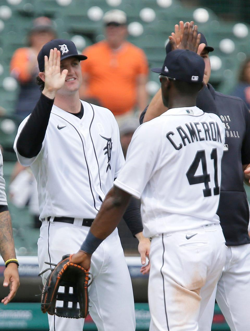 Detroit Tigers' Casey Mize, left, celebrates with Daz Cameron (41) after a win over the Houston Astros in the first baseball game of a doubleheader Saturday, June 26, 2021, in Detroit.