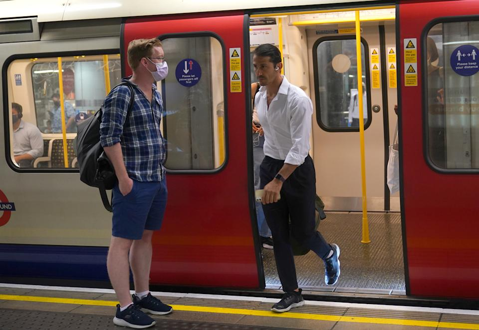 Commuters, some not wearing facemasks, getting off a Circle Line train at Westminster Underground station, at 0847 in London after the final legal Coronavirus restrictions were lifted in England. Picture date: Monday July 19, 2021.
