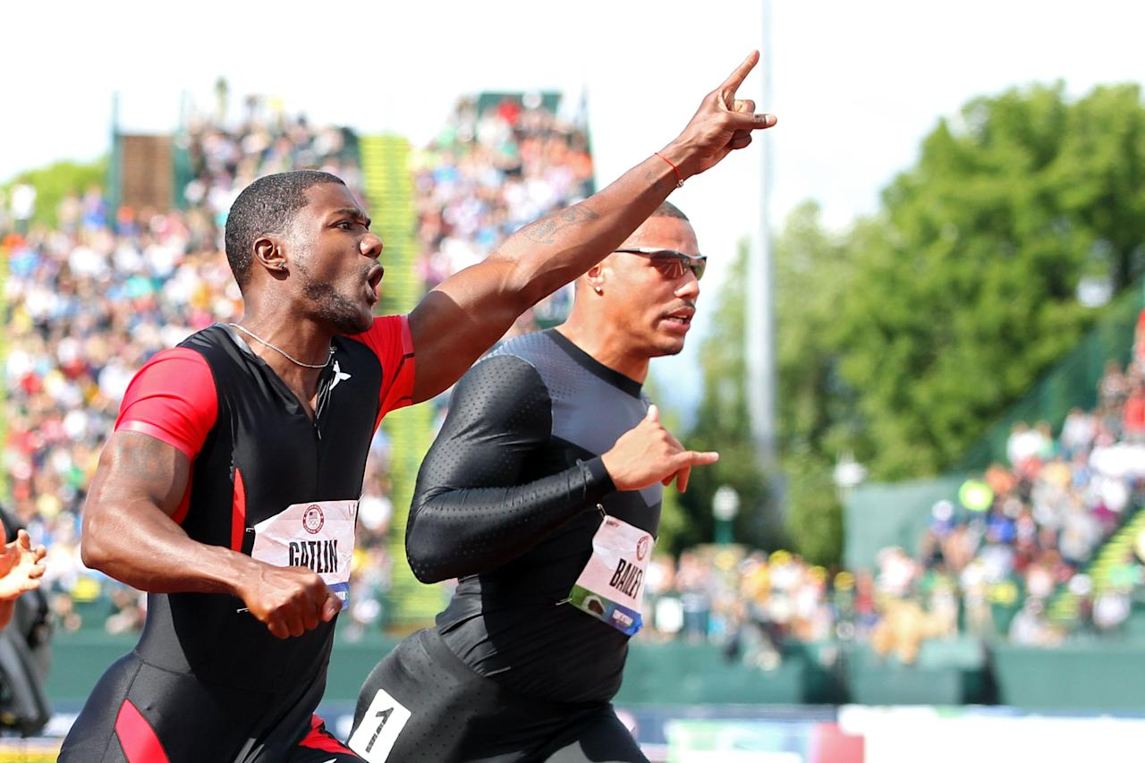 EUGENE, OR - JUNE 24:  Justin Gatlin celebrates after winning the men's 100 meter final in front of Ryan Bailey on Day Three of the 2012 U.S. Olympic Track & Field Team Trials at Hayward Field on June 24, 2012 in Eugene, Oregon.  (Photo by Christian Petersen/Getty Images)
