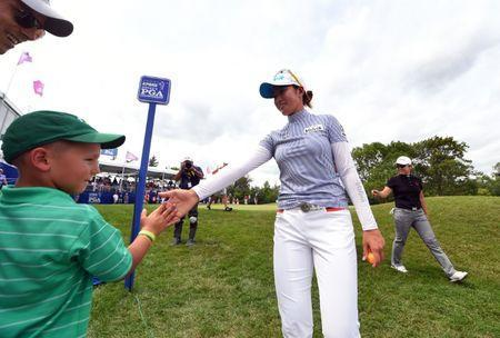Jun 29, 2017; Olympia Fields, IL, USA; Chella Choi high fives a fan after the first round of the KPMG Women's PGA Championship golf tournament at Olympia Fields Country Club - North. Thomas J. Russo-USA TODAY Sports
