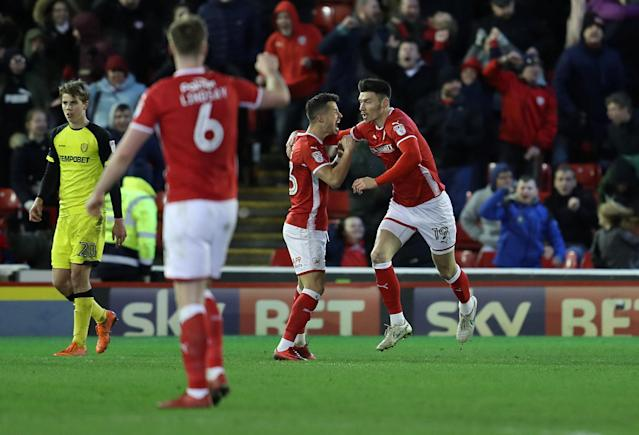 "Soccer Football - Championship - Barnsley vs Burton Albion - Oakwell, Barnsley, Britain - February 20, 2018 Barnsley's Daniel Pinillos celebrates scoring their first goal with Kieffer Moore Action Images/John Clifton EDITORIAL USE ONLY. No use with unauthorized audio, video, data, fixture lists, club/league logos or ""live"" services. Online in-match use limited to 75 images, no video emulation. No use in betting, games or single club/league/player publications. Please contact your account representative for further details."