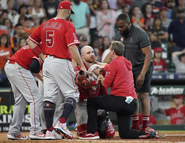 Angels catcher Jonathan Lucroy had to be carted off the field after a collision at home plate. (AP Photo/David J. Phillip)