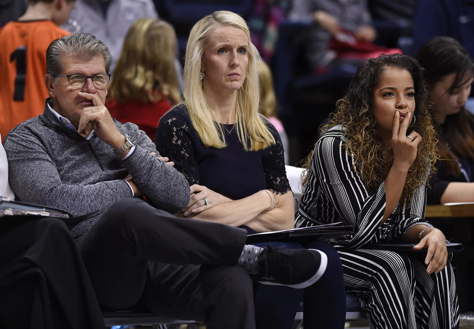 FILE - Connecticut head coach Geno Auriemma, left, watches play with assistant coaches Shea Ralph, center, and Jasmine Lister, right, during the second half of an NCAA exhibition women's college basketball game against Vanguard in Storrs, Conn., in this Sunday, Nov. 4, 2018, file photo. Vanderbilt has hired Shea Ralph away from UConn to help revive the Commodores' struggling women's basketball program. Athletic director Candice Lee announced the hiring Tuesday morning, April 13, 2021, a week after firing Stephanie White. (AP Photo/Jessica Hill, File)