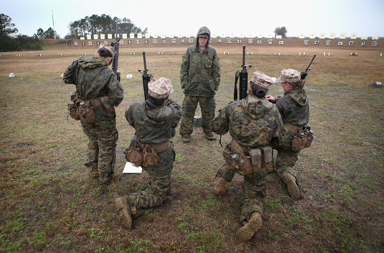PARRIS ISLAND, SC - FEBRUARY 25:  Cpl. David Peck (C) from New Market, Tennessee instructs female Marines as they prepare to fire on the rifle range during boot camp February 25, 2013 at MCRD Parris Island, South Carolina. All female enlisted Marines and male Marines who were living east of the Mississippi River when they were recruited attend boot camp at Parris Island. About six percent of enlisted Marines are female.   (Photo by Scott Olson/Getty Images)