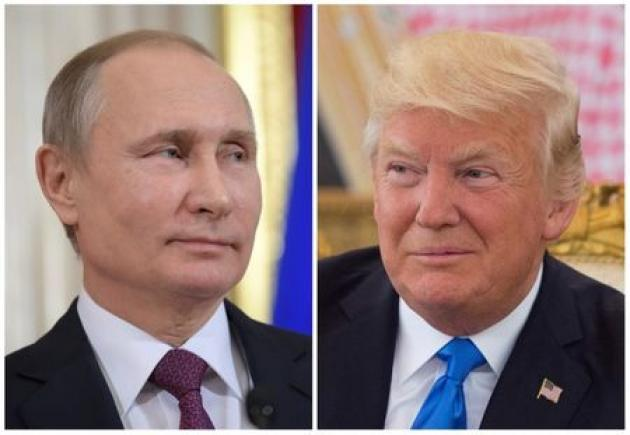 Before Putin talks, Trump plays down interference in U.S. election