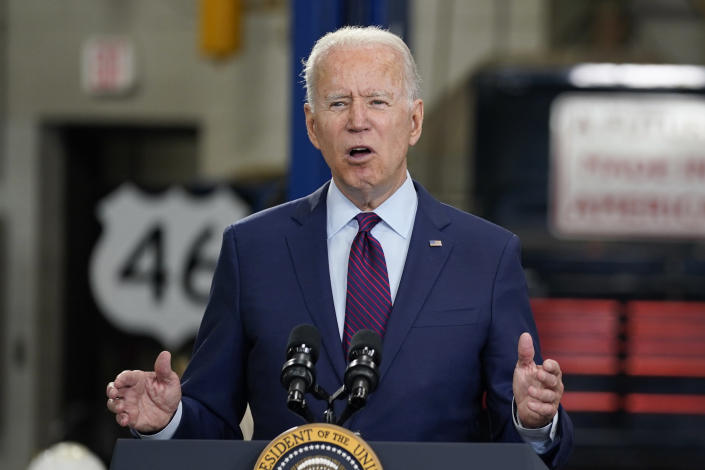 FILE - In this June 29, 2021, file photo President Joe Biden speaks about infrastructure spending at the La Crosse Municipal Transit Authority in La Crosse, Wis. President Joe Biden speaks volumes when he whispers. And his whispers during recent public appearances are attracting attention. The White House and communications experts say it's Biden's way of trying to make a connection while emphasizing a point. (AP Photo/Evan Vucci, File)