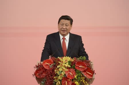 Chinese President Xi Jinping gives a speech during his visit in Macau to celebrate the 15th anniversary of its handover to the mainland, December 19, 2014. REUTERS/Government Information Bureau of the MSAR/Handout via Reuters