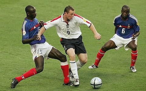 Wayne Rooney of England gets past LilianThuram of France during the France v England Group B match - Credit: Phil Cole/Getty Images