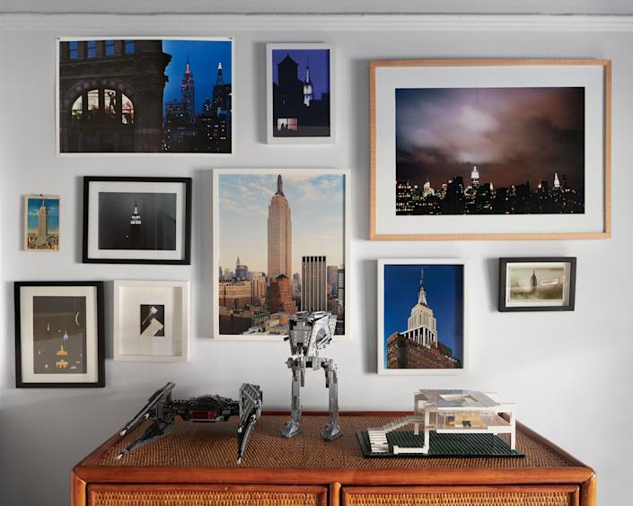 Photos of the Empire State Building by Schmidt and others in Jules's room.