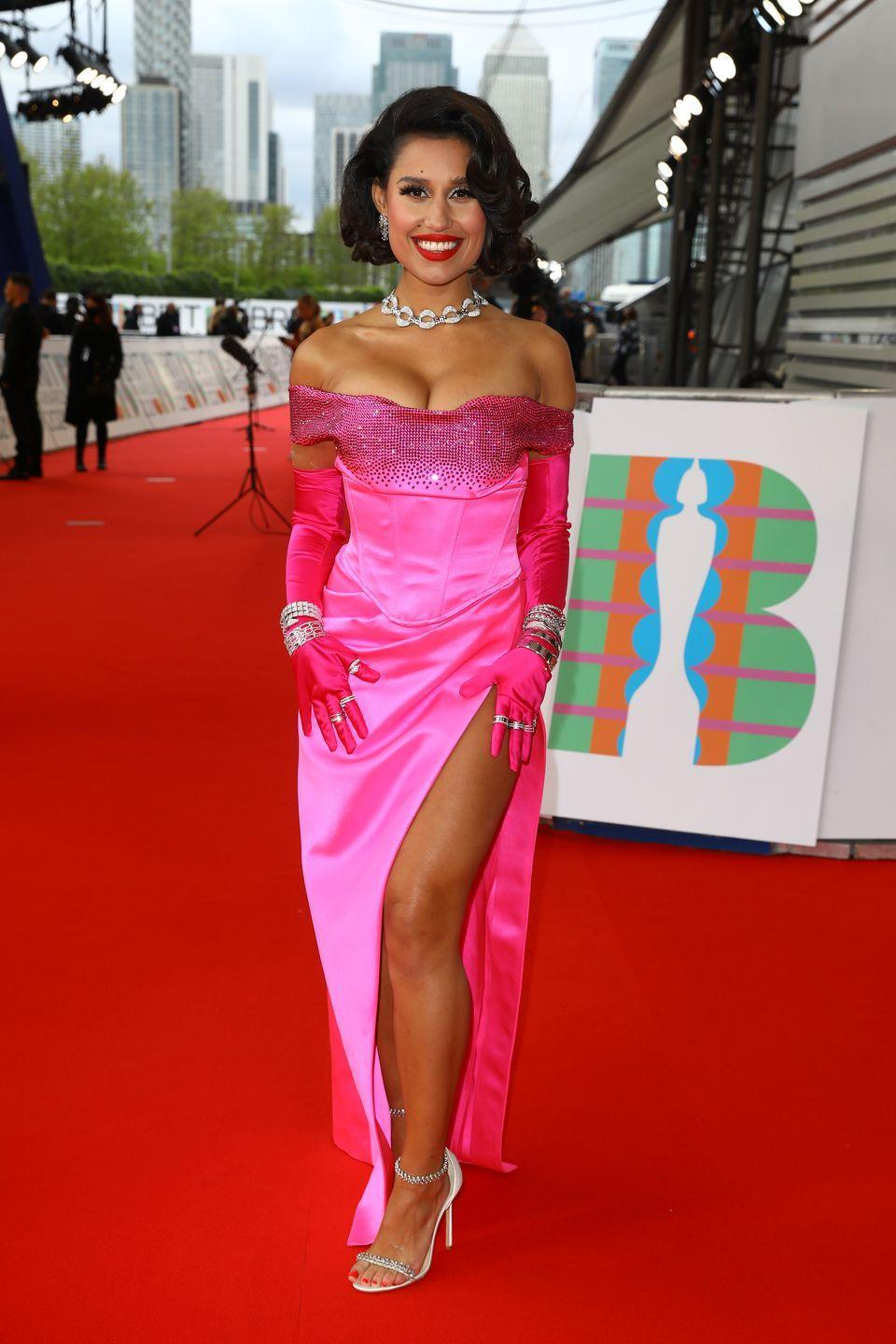 <p>Raye was inspired by Marilyn Monroe's iconic look in Gentlemen Prefer Blondes, wearing a bright pink dress by Etro, which she teamed with Bulgari jewellery.</p>