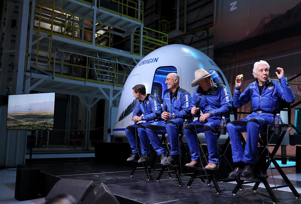 VAN HORN, TEXAS - JULY 20: Blue Origin's New Shepard crew (L-R) Oliver Daemen, Mark Bezos, Jeff Bezos, and Wally Funk hold a press conference after flying into space in the Blue Origin New Shepard rocket on July 20, 2021 in Van Horn, Texas. Mr. Bezos and the crew were the first human spaceflight for the company.   Joe Raedle/Getty Images/AFP / AFP / GETTY IMAGES NORTH AMERICA / JOE RAEDLE