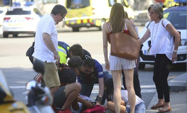 <p>A van veered onto a sidewalk and sped down a busy pedestrian zone Thursday in Barcelona's picturesque Las Ramblas district, swerving from side to side as it mowed down tourists and residents and turned the popular European vacation spot into a bloody killing zone. </p>