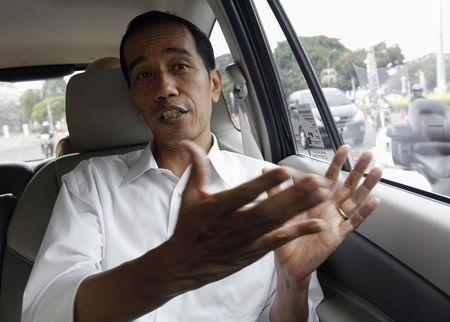 Jakarta's Governor Joko Widodo speaks during an interview with Reuters in his car on his way back to his office in Jakarta