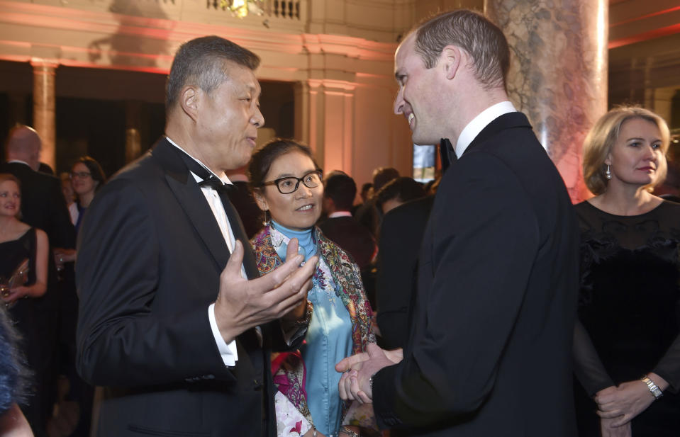 FILE - In this Nov. 30, 2016 file photo, Chinese Ambassador to the United Kingdom, Liu Xiaoming, left, speaks with Britain's Prince William, Duke of Cambridge during the Tusk Conservation Awards at Victoria and Albert Museum in London. Much of the popular support Liu, who recently stepped down as China's ambassador to the U.K., and his colleagues seem to enjoy on Twitter has, in fact, been manufactured, an AP and Oxford Internet Institute investigation found. More than one in ten retweets of Chinese diplomats came from accounts Twitter suspended for breaking platform rules, which bar manipulation. (Stuart C. Wilson/Pool Photo via AP, File)