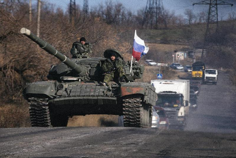 Pro-Russian separatists ride on top of a tank near the town of Krasnyi Luch in the Lugansk region, eastern Ukraine, on October 28, 201 (AFP Photo/Dimitar Dilkoff)