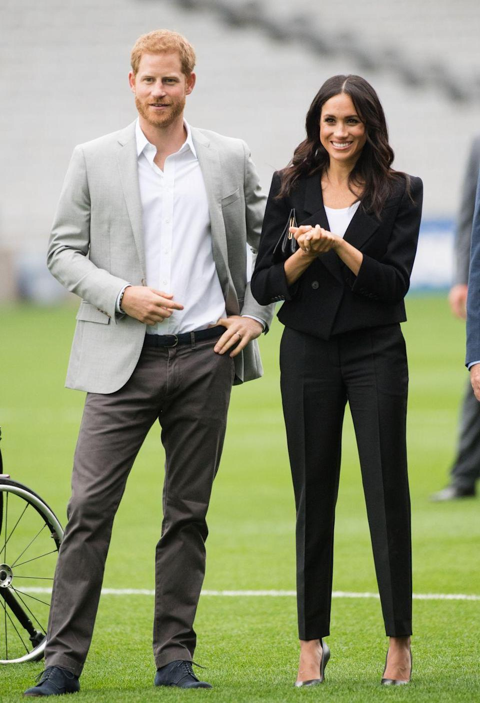 """<p><a href=""""https://www.townandcountrymag.com/style/fashion-trends/a22113279/meghan-markle-black-pants-suit-dublin-royal-visit-2018/"""" rel=""""nofollow noopener"""" target=""""_blank"""" data-ylk=""""slk:For her second outfit of the day,"""" class=""""link rapid-noclick-resp"""">For her second outfit of the day,</a> Meghan wore a sleek Givenchy pantsuit with <a href=""""https://go.redirectingat.com?id=74968X1596630&url=https%3A%2F%2Fwww.sarahflint.com%2Fproducts%2Fperfect-pump-100-black-nappa-2%3Fvariant%3D8211317948513&sref=https%3A%2F%2Fwww.townandcountrymag.com%2Fstyle%2Ffashion-trends%2Fg3272%2Fmeghan-markle-preppy-style%2F"""" rel=""""nofollow noopener"""" target=""""_blank"""" data-ylk=""""slk:a pair of pumps by Sarah Flint"""" class=""""link rapid-noclick-resp"""">a pair of pumps by Sarah Flint</a>, one of the <a href=""""https://www.townandcountrymag.com/style/fashion-trends/g12478382/meghan-markle-favorite-fashion-brands-designers/"""" rel=""""nofollow noopener"""" target=""""_blank"""" data-ylk=""""slk:Duchess's favorite designers."""" class=""""link rapid-noclick-resp"""">Duchess's favorite designers.</a></p>"""