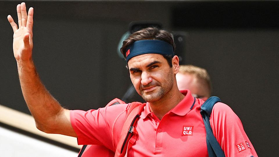 Roger Federer is pictured waving to fans at the French Open.
