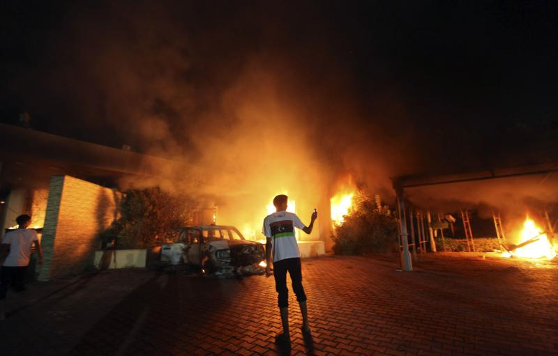 File photo of the U.S. Consulate in Benghazi in flames during a protest