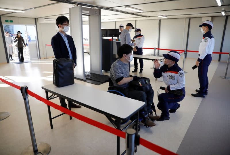 Security officers conduct a screening measures test for spectators ahead of Tokyo 2020 Olympic and Paralympic Games