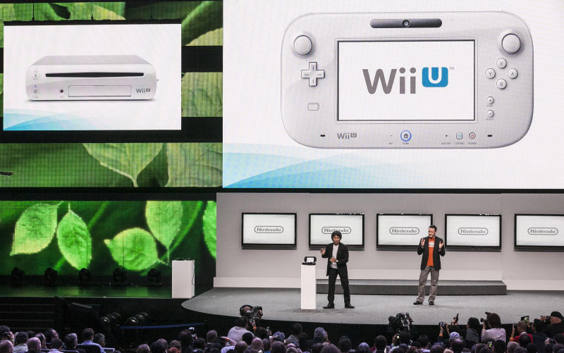Shigeru Miyamoto, senior manager director of Nintendo Co., Ltd., left, with Bill Trinen, director of product marketing of Treehouse, introduce the Wii U at the Nintendo All-Access presentation at the E3 2012 in Los Angeles Tuesday, June 5, 2012. The Electronic Entertainment Expo runs from June 5-7 in Los Angeles. (AP Photo/Damian Dovarganes)