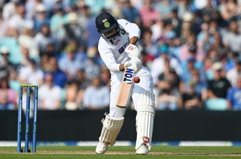 Hitting out: India's Shardul Thakur drives England's Ollie Robinson for six on his way to a second fifty in the fourth Test at the Oval (AFP/Glyn KIRK)