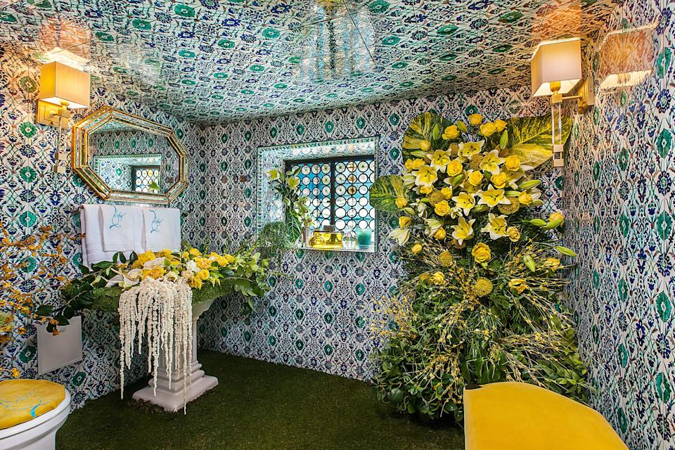 A tiled powder room decorated by Lashee Floral.