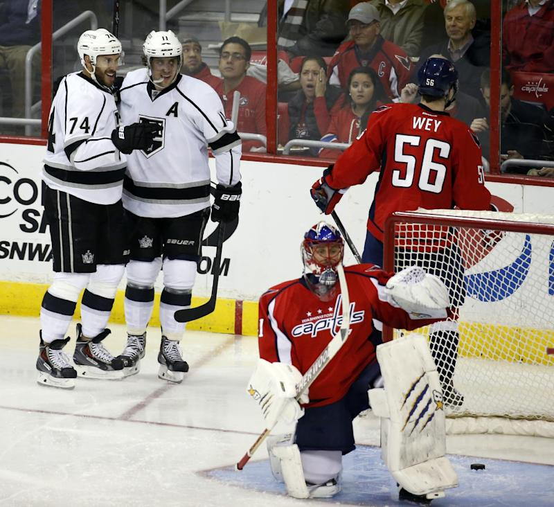 Los Angeles Kings left wing Dwight King (74) and center Anze Kopitar (11), from Slovenia,  celebrate King's goal behind Washington Capitals goalie Jaroslav Halak (41), from the Czech Republic, in the third period of an NHL hockey game, Tuesday, March 25, 2014, in Washington. The Kings won 5-4 in a shootout