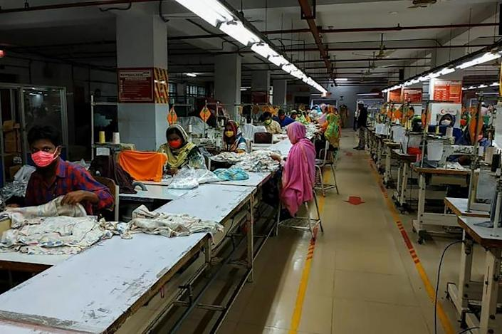 "Bangladesh's garment factories are ""under pressure"" from brands to meet export deadlines despite the pandemic, an industry group said (AFP Photo/STR)"