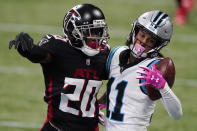 Carolina Panthers wide receiver Robby Anderson (11) makes the catch against Atlanta Falcons defensive back Kendall Sheffield (20) during the first half of an NFL football game, Sunday, Oct. 11, 2020, in Atlanta. (AP Photo/John Bazemore)