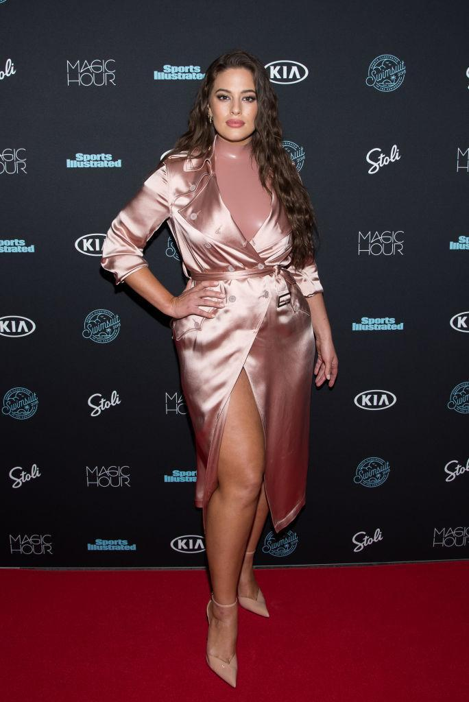 <p>Model Ashley Graham donned a latex bodysuit and silky trench for a Sports Illustrated swimsuit event in New York. <em>[Photo: Getty]</em> </p>