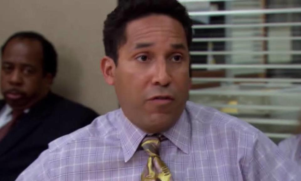 A still from the third season of The Office US where Oscar Martinez is outed by his boss to the entire office