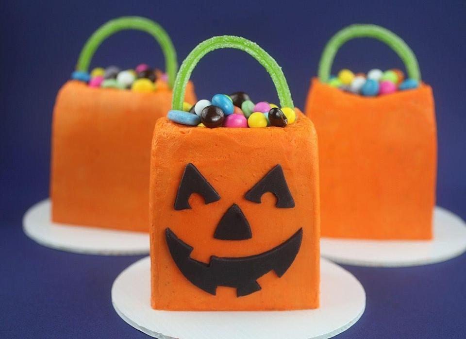 """<p>Tiny cakes with tiny candies on top= a completely delightful treat!</p><p><a class=""""link rapid-noclick-resp"""" href=""""https://www.bakerella.com/trick-or-treat-mini-cakes/"""" rel=""""nofollow noopener"""" target=""""_blank"""" data-ylk=""""slk:GET THE RECIPE"""">GET THE RECIPE</a></p>"""