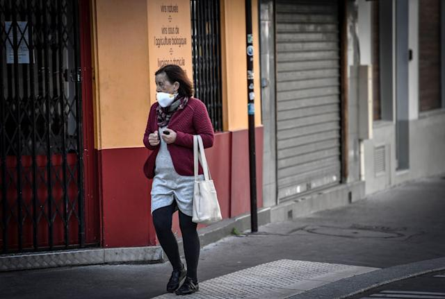 A woman wearing a mask walks in Paris. (Getty Images)