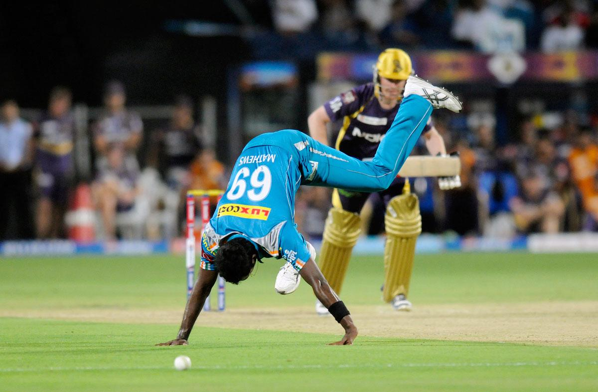 Angelo Mathews  of Pune Warriors tries to stop a ball of his own bowling during match 56 of the Pepsi Indian Premier League ( IPL) 2013  between The Pune Warriors India and the Kolkata Knight Riders held at the Subrata Roy Sahara Stadium, Pune on the 9th May 2013. (BCCI)