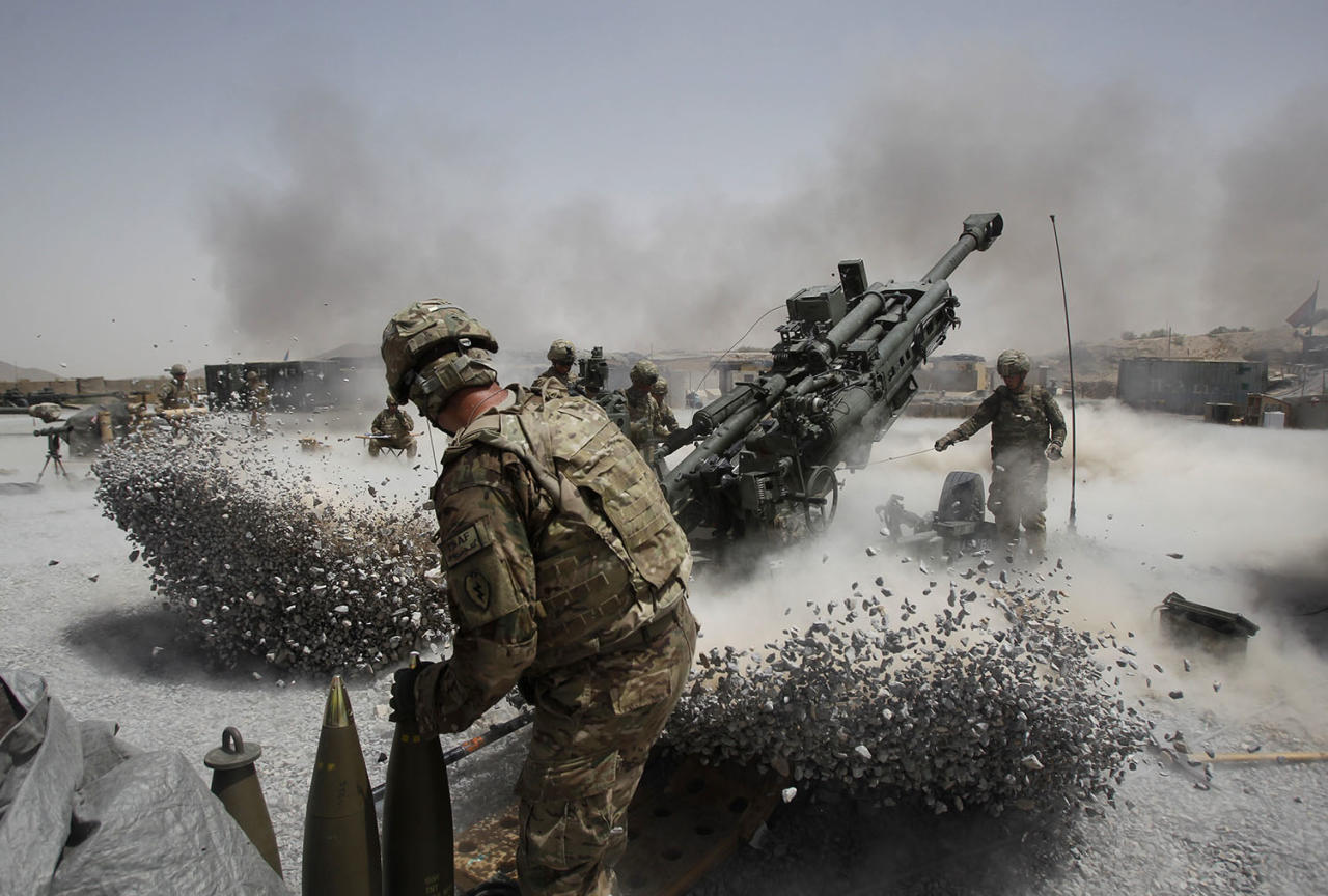 <p>U.S. Army soldiers from the 2nd Platoon, B battery 2-8 field artillery, fire a howitzer artillery piece at Seprwan Ghar forward fire base in Panjwai district, Kandahar province southern Afghanistan, June 12, 2011. (Photo: Baz Ratner/Reuters) </p>
