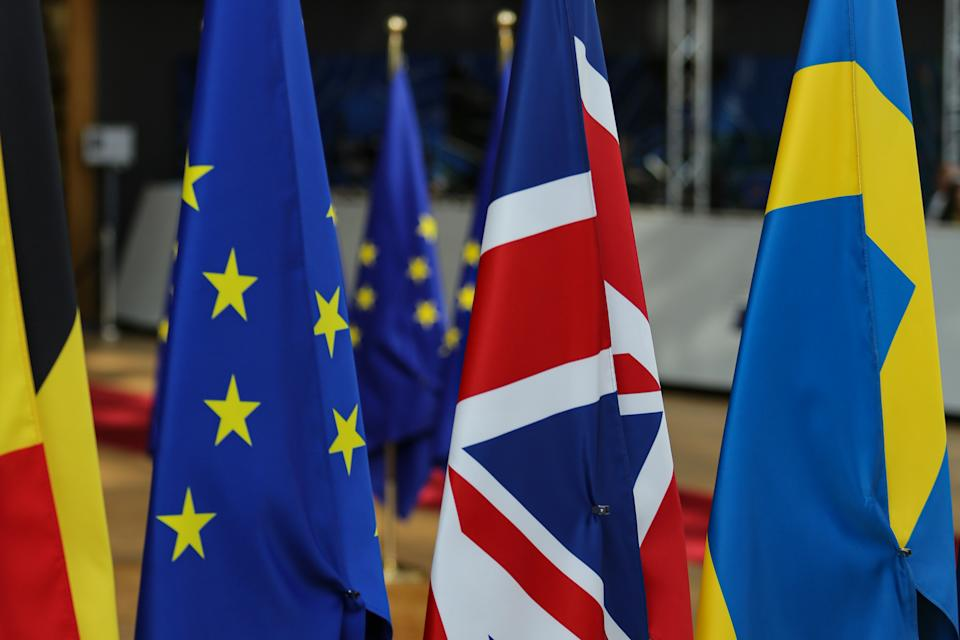Flags of the European Union EU and the United Kingdom UK / Great Britain among all the other European flags in Forum Europa Building in Brussels, Belgium, during the European Council summit - special meeting of EU Leaders about Article 50 and the departure of United Kingdom from EU, Brexit on October 2019 (Photo by Nicolas Economou/NurPhoto via Getty Images)