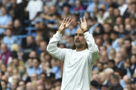 Manchester City's head coach Pep Guardiola reacts during the English Premier League soccer match between Manchester City and Norwich City at Etihad stadium in Manchester, England, Saturday, Aug. 21, 2021. (AP Photo/Rui Vieira)