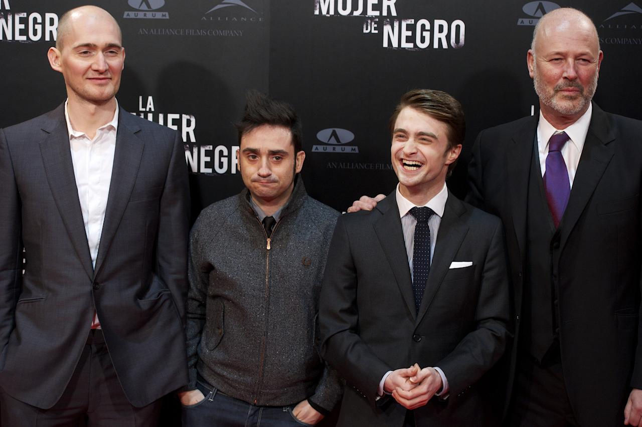 """MADRID, SPAIN - FEBRUARY 14:  (L to R) Director James Watkins, Spanish director Juan Antonio Bayona, actor Daniel Radcliffe and producer Simon Oakes attend """"The Woman in Black"""" (La Mujer de Negro) premiere at Callao cinema on February 14, 2012 in Madrid, Spain.  (Photo by Carlos Alvarez/Getty Images)"""