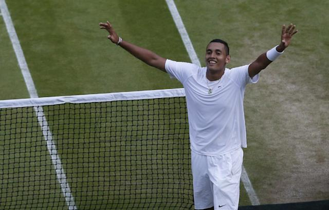 Nick Kyrgios of Australia celebrates defeating Rafael Nadal of Spain in their men's singles match on Centre Court at the All England Lawn Tennis Championships in Wimbledon, London, Tuesday July 1, 2014. (AP Photo/Sang Tan)