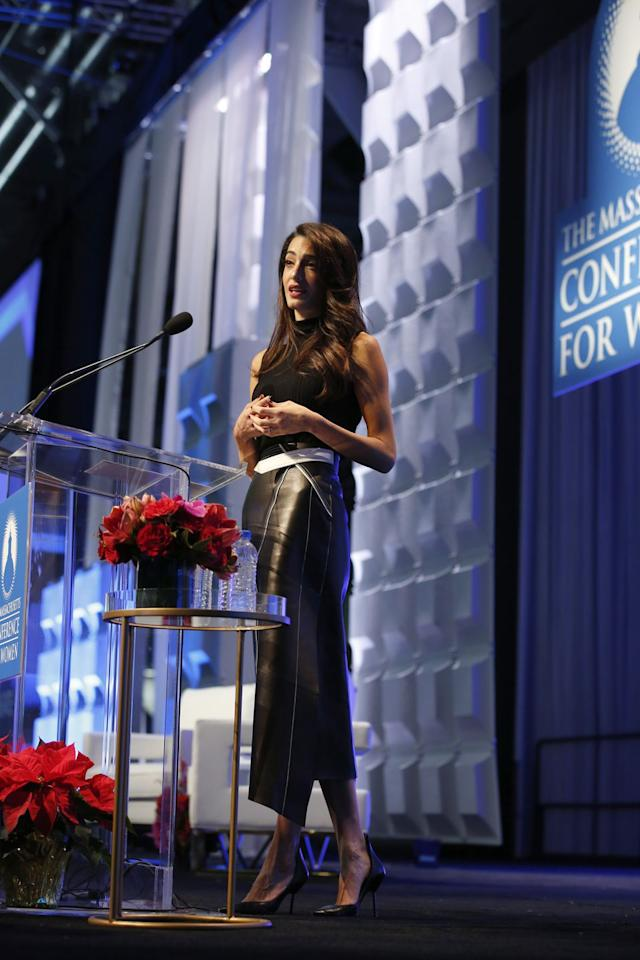 <p>Amal Clooney wore a sleeveless black turtleneck with a mid-length leather skirt with white detailing to speak at the 2018 Massachusetts Conference For Women in Boston. </p>